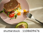 avocado on toast with eggs and... | Shutterstock . vector #1108609676