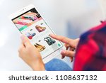 young woman shopping online... | Shutterstock . vector #1108637132