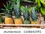 image from pineapples on a... | Shutterstock . vector #1108642592