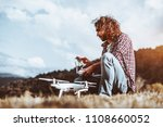 a handsome adult curly man with ... | Shutterstock . vector #1108660052
