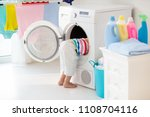 child in laundry room with... | Shutterstock . vector #1108704116