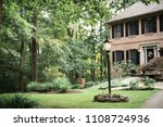 brick house and front yard with ... | Shutterstock . vector #1108724936