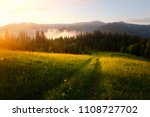 mountain valley during sunrise. ... | Shutterstock . vector #1108727702
