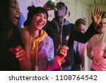 young men and women enjoying at ...   Shutterstock . vector #1108764542