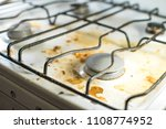dirty messy white gas stove... | Shutterstock . vector #1108774952