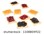some dry biscuits with jam on a ... | Shutterstock . vector #1108804922