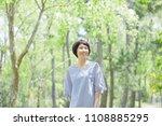 smiling asian woman | Shutterstock . vector #1108885295