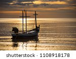 Fishing Boat Floating In The...