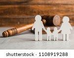 family figure and gavel on... | Shutterstock . vector #1108919288