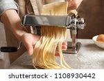 young woman preparing noodles... | Shutterstock . vector #1108930442
