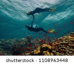 freediver couple looking at the ... | Shutterstock . vector #1108963448