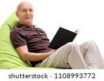 senior with a book sitting on a ... | Shutterstock . vector #1108993772