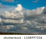 white clouds against the blue...   Shutterstock . vector #1108997336