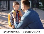 young man saying goodbye to his ... | Shutterstock . vector #1108999145