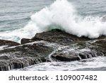 waves crashing along the... | Shutterstock . vector #1109007482