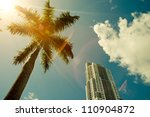 green palm tree on blue sky... | Shutterstock . vector #110904872
