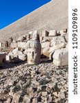 Small photo of Nemrut Mountain, Anatolia, Turkey top the god Apollo, (Mithra) and ancient stone statues of the Goddess Tyche of Commagene ruins.