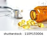 colored pills poured from a... | Shutterstock . vector #1109153006