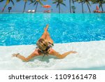 woman at the swimming pool at... | Shutterstock . vector #1109161478