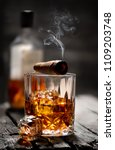 cigar and glass with whiskey... | Shutterstock . vector #1109203748
