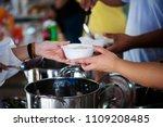 donate food to the beggar.... | Shutterstock . vector #1109208485
