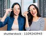 two happy beautiful women on... | Shutterstock . vector #1109243945