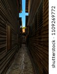 narrow path down the alley is... | Shutterstock . vector #1109269772