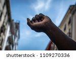 the raised fist. a black man... | Shutterstock . vector #1109270336