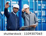 two engineers wearing hardhats... | Shutterstock . vector #1109307065