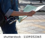 tourist holding the map. | Shutterstock . vector #1109352365