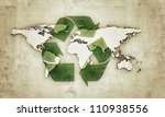 extruded continents with recycle symbol in old grunge photo - stock photo