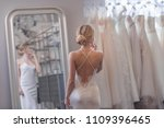 attractive girl at the mirror... | Shutterstock . vector #1109396465