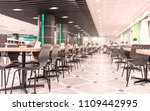 Stock photo modern interior of cafeteria or canteen with chairs and tables eating room in selective focus 1109442995