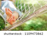 young woman relaxing on hammock ... | Shutterstock . vector #1109473862