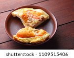 homemade pizza on a clay plate  ... | Shutterstock . vector #1109515406