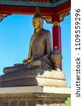Small photo of Elista, Kalmykia, Russia - June 3, 2018: Pagoda with Statue of seated great Buddhist teacher of the monastery of Nalanda in Buddhist complex Golden Abode of Buddha Shakyamuni