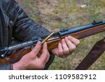 men holding the bullet to... | Shutterstock . vector #1109582912