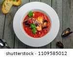 plate of tomato seafood soup on ... | Shutterstock . vector #1109585012