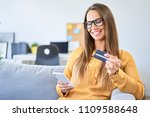 young woman using credit card... | Shutterstock . vector #1109588648
