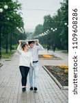 attractive couple in the rain...   Shutterstock . vector #1109608286