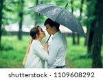 attractive couple under an...   Shutterstock . vector #1109608292
