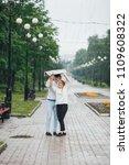 attractive couple in the rain...   Shutterstock . vector #1109608322