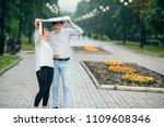attractive couple in the rain...   Shutterstock . vector #1109608346