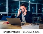 weary businessman finishing up... | Shutterstock . vector #1109615528