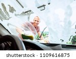 man washes his car front window ... | Shutterstock . vector #1109616875