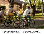 friends biking in park  back... | Shutterstock . vector #1109620958
