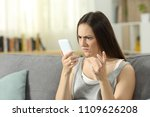angry woman looking at smart... | Shutterstock . vector #1109626208
