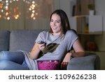 happy woman watching tv content ... | Shutterstock . vector #1109626238