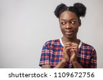 Small photo of close up portrait of cunny African girl making up meanness. get back at friend. bad thoughts. plan. copyspace