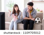 family pair watching football... | Shutterstock . vector #1109705012